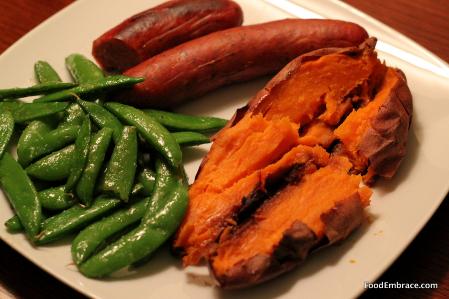 Brat, baked sweet potato, and sugar peas