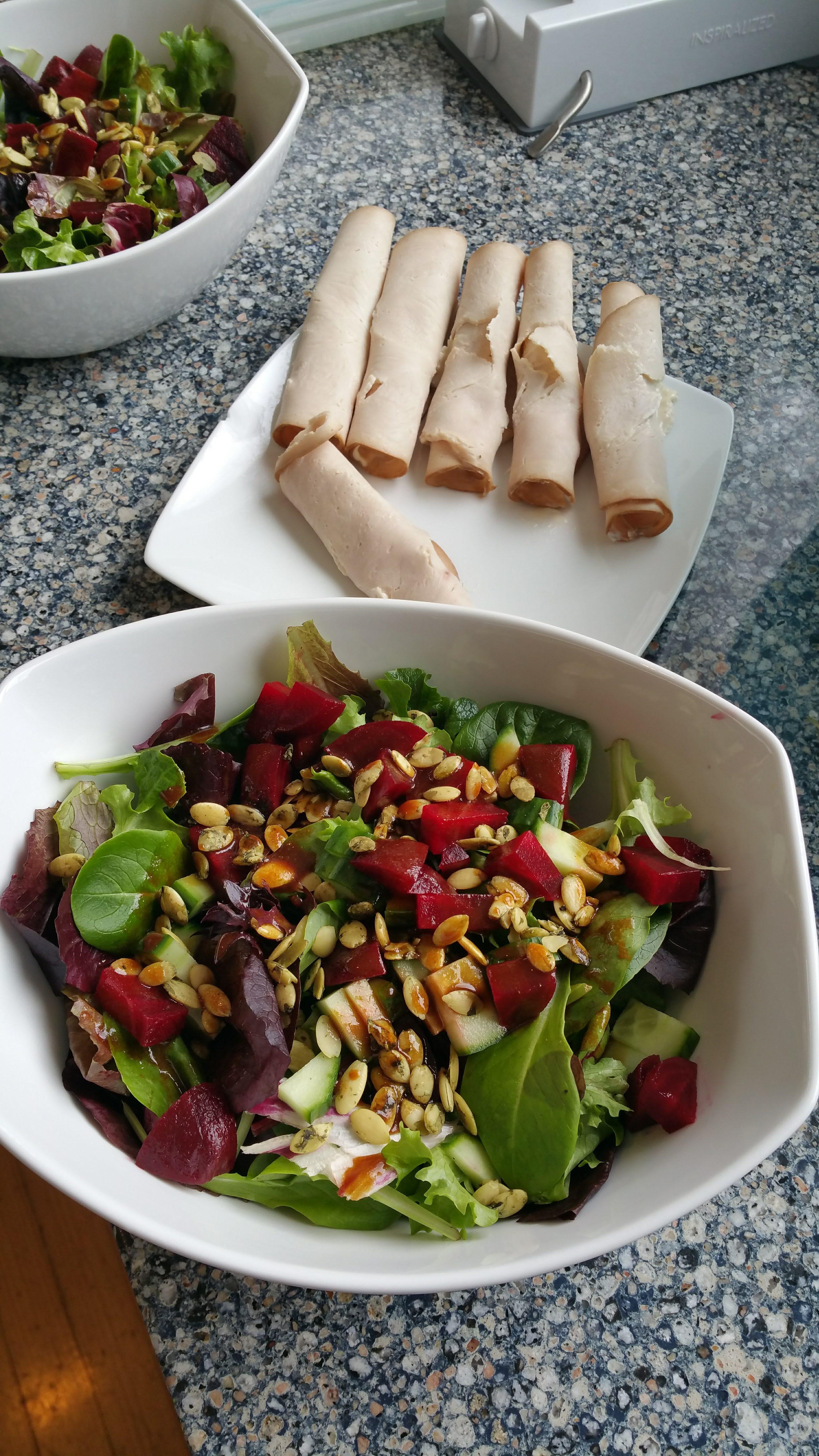 Salad and turkey slices