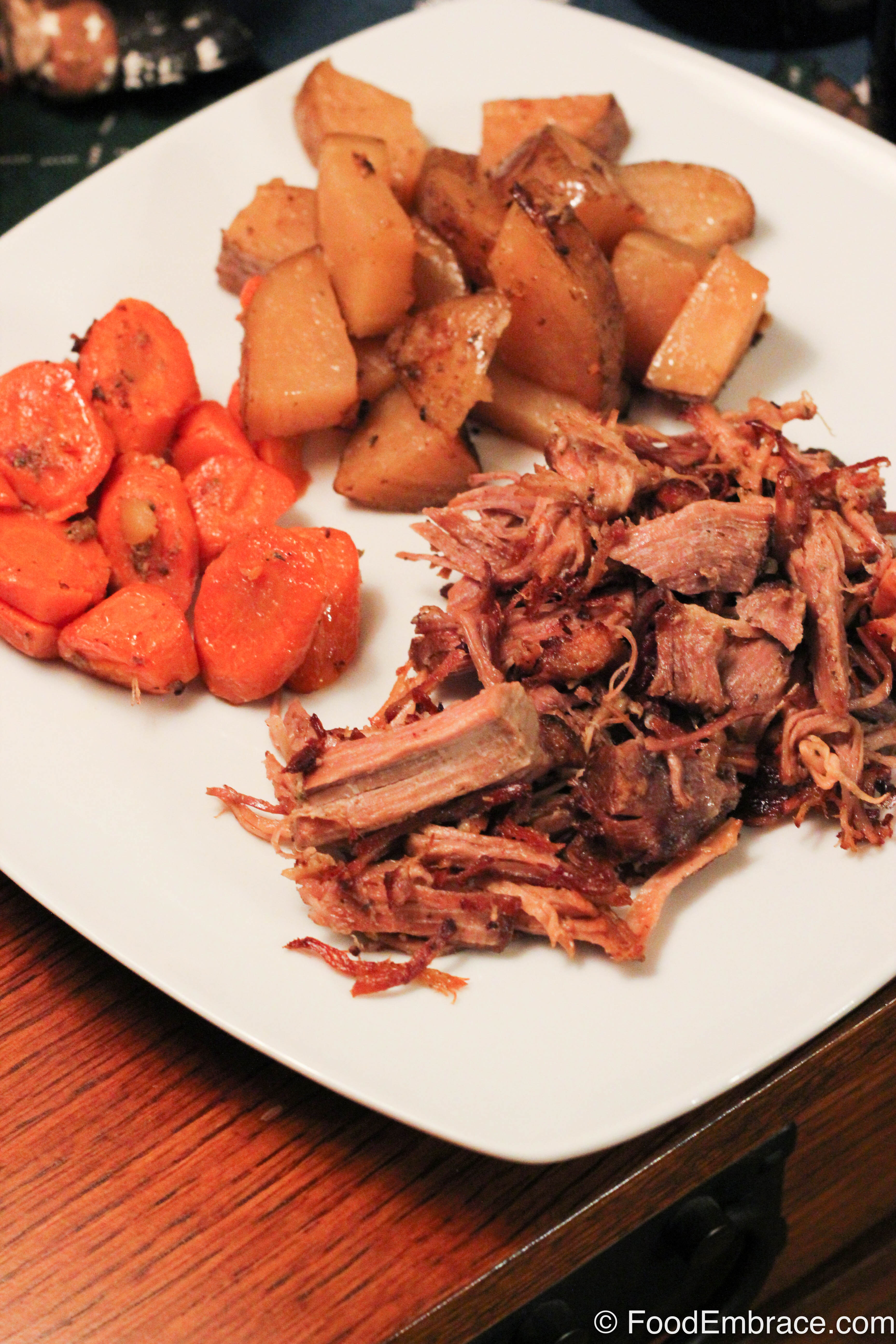Crispy pork with potatoes and carrots.